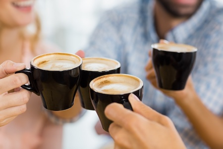 Group of employees enjoying cups of hot coffee