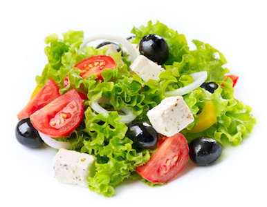Fresh salad with lettuce, tomatoes, and onion